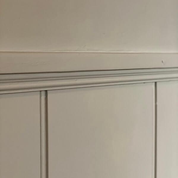 beading moulding under shelf with panelling