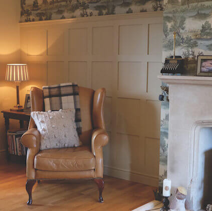 Jacobean wall panelling with Armchair